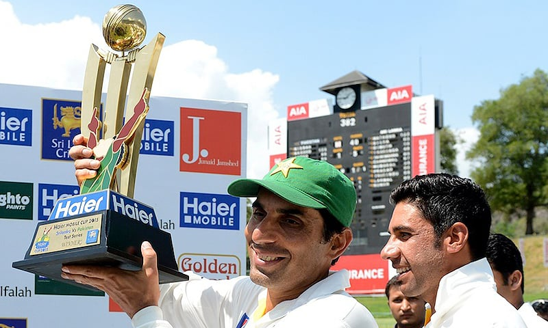 Misbah-ul-Haq with the series trophy. — AFP