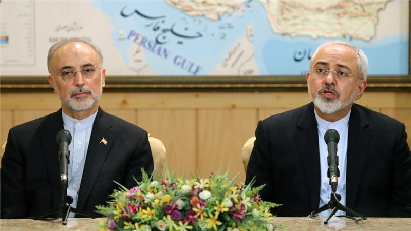 Foreign Minister Mohammad Javad Zarif, right, who led the negotiations, is now back in Tehran [AP]