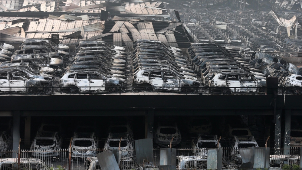 The blasts started late on Wednesday after a container of 'hazardous material' exploded in a warehouse in Tianjin [EPA]