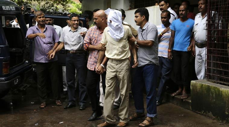 Indrani Mukerjea's former husband Sanjeev Khanna (in mask) in police custody. Photo: IE