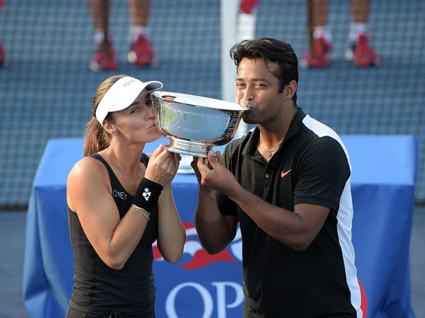 Martina Hingis and Leander Paes kiss the trophy after winning the mixed doubles title at the 2015 US Open. Photo Courtesy: US Open website
