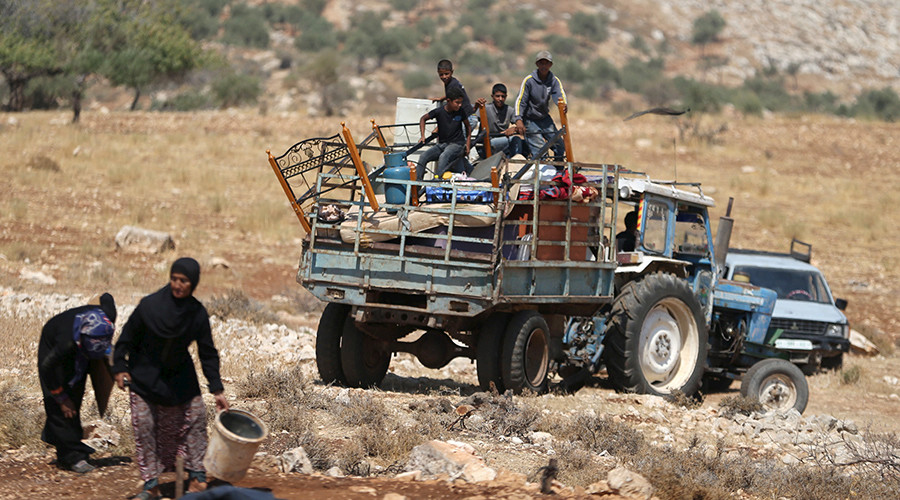 Palestinians ride a truck loaded with their belongings after their shanty was demolished by the Israeli army east of the West Bank city of Ramallah © Mohamad Torokman / Reuters