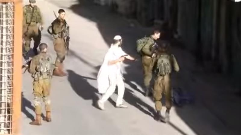 Video footage showed the moment after an Israeli settler shot dead a Palestinian man in Hebron [YouTube]
