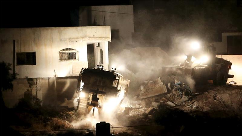 Israeli troops withdrew from the camp after demolishing Majdi Abu al-Heija's home [Mohamad Torokman/Reuters]