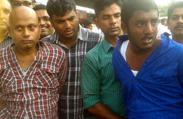 (Left) Harish Babu and Madhu (in blue shirt) were picked up from a train at Nagpur Railway Station