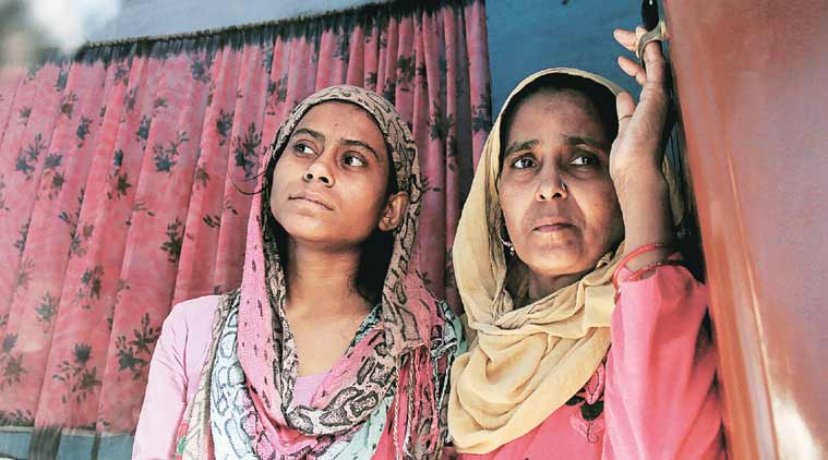 Akhlaq's daughter and sister at his residence in Bisara village, in Dadri. (Photo: IE by Gajendra Yadav)