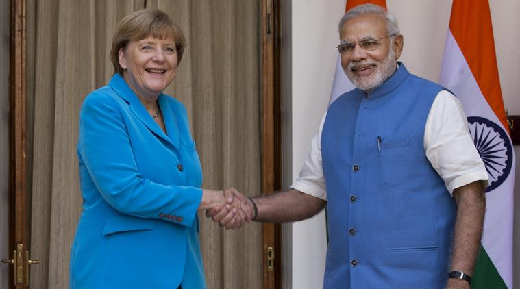German Chancellor, Angela Merkel, ileft, and Indian Prime Minister Narendra Modi pose for a photograph before a meeting in New Delhi, India, Monday, Oct. 5, 2015.  Merkel is on a three-day visit to India. (AP Photo/Saurabh Das)