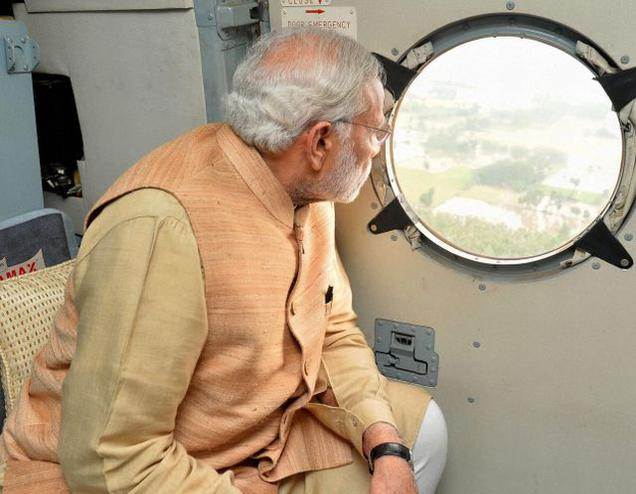 Prime Minister Narendra Modi conducting an aerial survey of rain hit areas of Chennai on Thursday.
