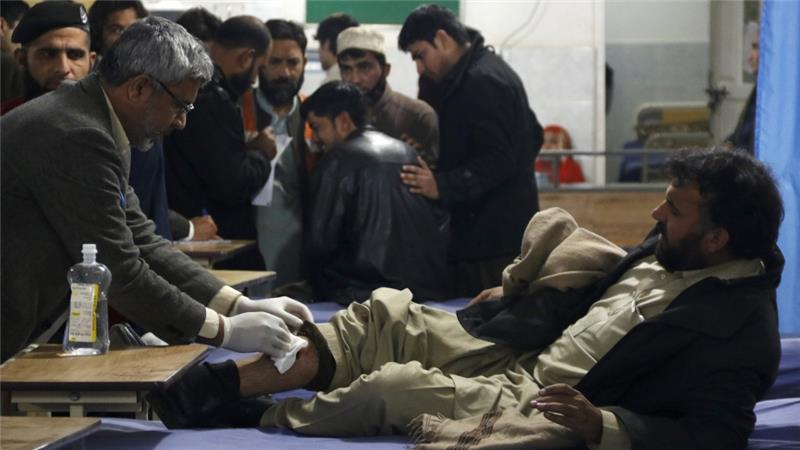 More than 40 people were being treated at the city's main hospital after a Taliban suicide bomber blew himself outside a government office [Khuram Parvez/Reuters]