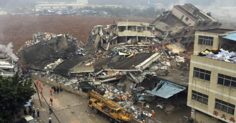 A landslide struck the city of Shenzhen, China Sunday, toppling buildings and leaving dozens of people missing. (Photo: ChinaTopix/AP)