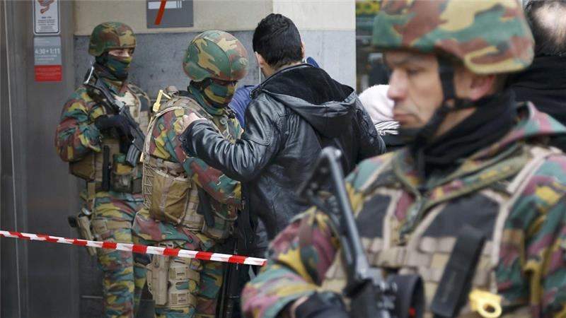 Belgian troops search people entering a subway station following Tuesday''s bomb attacks [Francois Lenoir/Reuters]