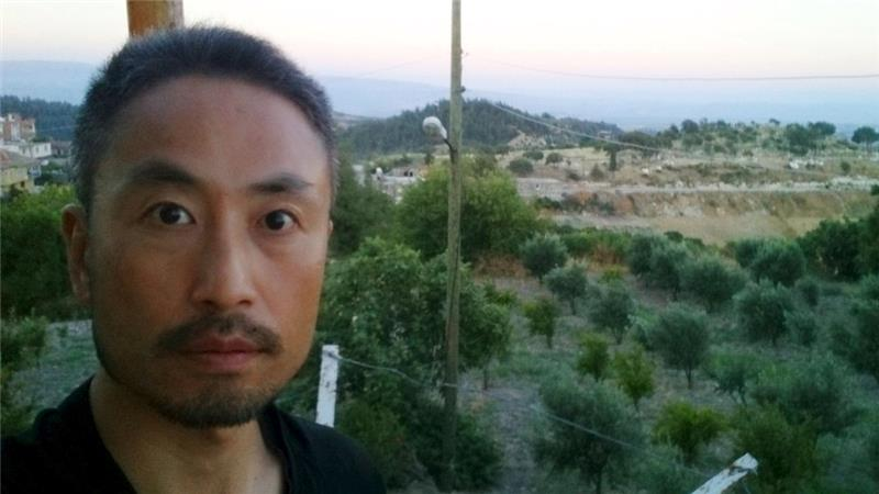 Yasuda, a freelance journalist, was seen in the video reading a message to his family and country [Reuters]