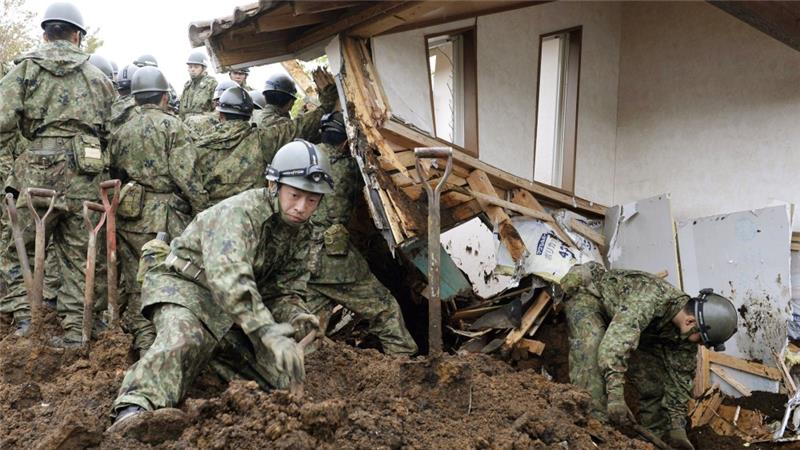 Japan's Self-Defence Force search for missing persons at the site of a landslide in Minamiaso, Kumamoto [Takuya Inaba/Kyodo News via AP]