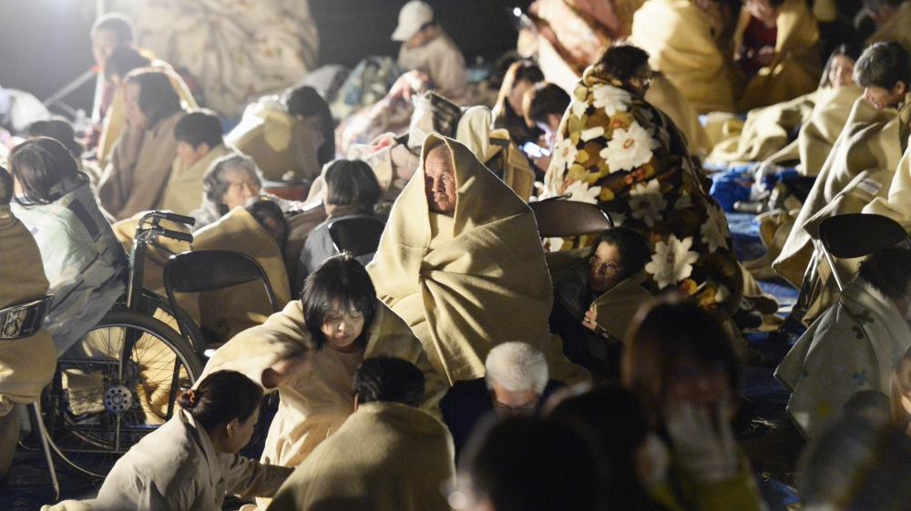 Japanese media showed residents, some of them wrapped in blankets, huddling in a parking lot [Kyodo News]