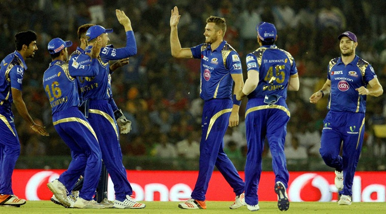 Mumbai Indians players celebrates the wicket of Kings XI Punjab player Murli Vijay  during their IPL match at the IS Bindra Stadium, Mohali on Monday. PTI Photo.