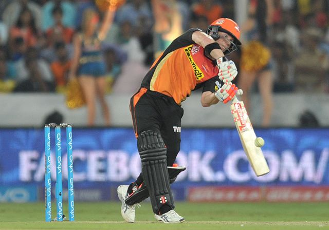 Sunrisers Hyderabad captain David Warner plays a shot during the 2016 Indian Premier League (IPL) Twenty20 cricket match between Sunrisers Hyderabad and Mumbai Indians at The Rajiv Gandhi International Stadium in Hyderabad on April 18, 2016. AFP / Noah SEELAM
