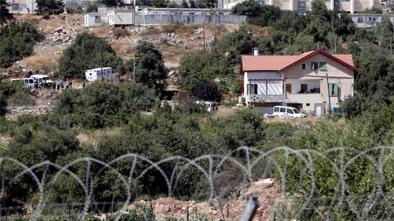 The teenage settler was killed in a house on the edge of the Kiryat Arba settlement [Mussa Qawasma/Reuters]