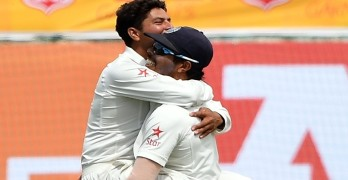 India's Kuldeep Yadav (L) celebrates the wicket of Australia's Glenn Maxwell with teammate Umesh Yadav during the fourth and last Test cricket match between India and Australia at The Himachal Pradesh Cricket Association Stadium in Dharamsala on March 25, 2017. ----IMAGE RESTRICTED TO EDITORIAL USE - STRICTLY NO COMMERCIAL USE----- / GETTYOUT---- / AFP PHOTO / PRAKASH SINGH /